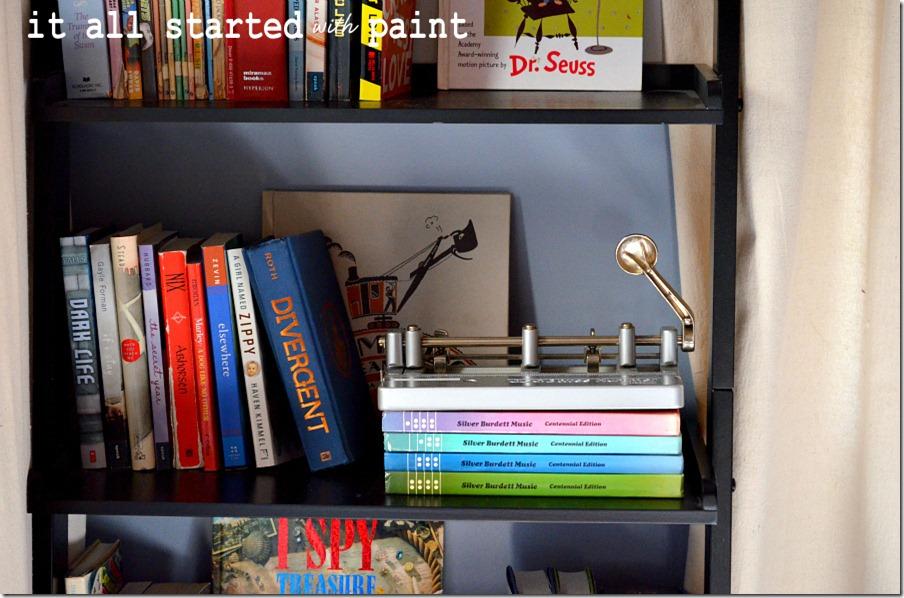 vintage-three-hole-punch-on-bookcase